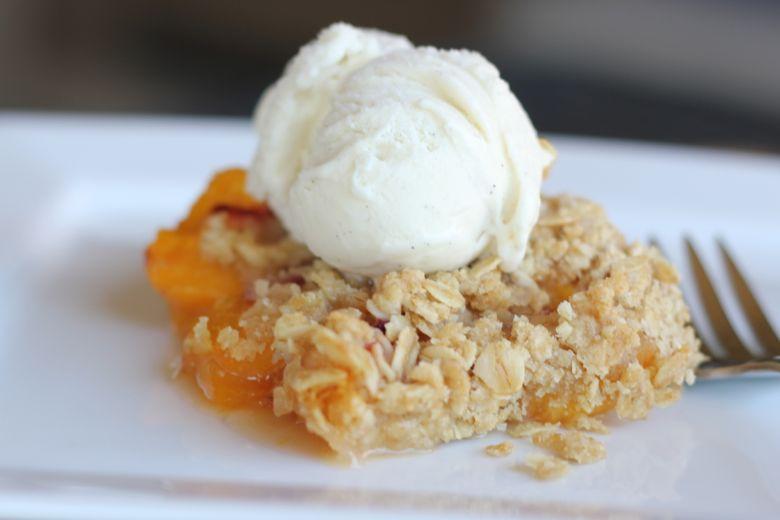 Peach Crisp with ice cream on top.