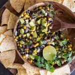 Quick and easy Avocado Dip! Everyone LOVES this fresh mix of avocado, black beans, and corn!