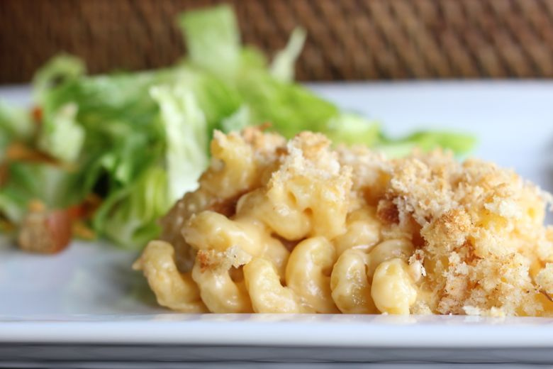 Mac and Cheese with real breadcrumbs on a plate with a side salad.