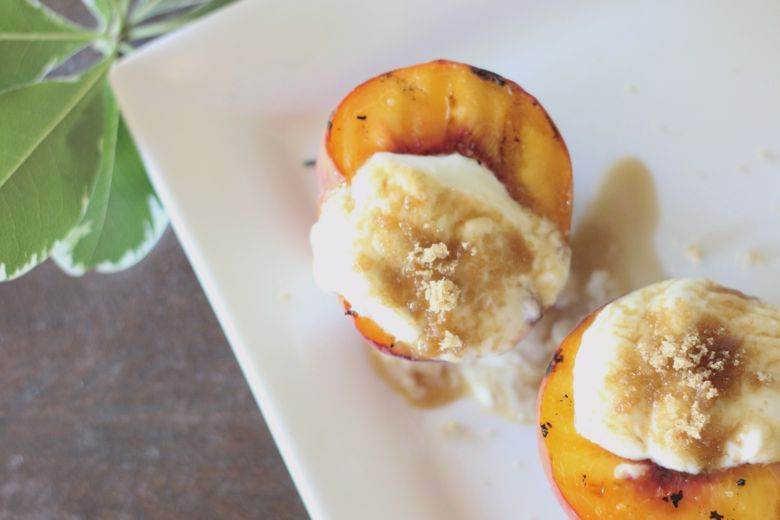 Grilled Peaches With Yogurt Cream on top.
