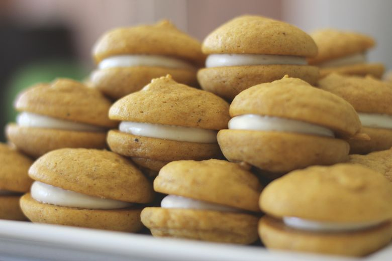 Soft Pumpkin Cream Cookies stacked on a plate.
