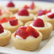 Sugar cookie tarts filled with sweetened cream cheese and topped with berries.