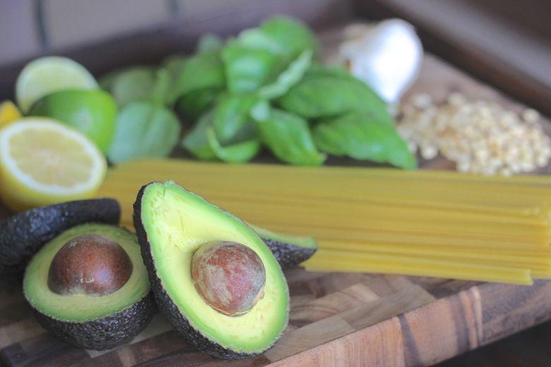 Avocado Pesto Linguine ingredients on a cutting board.