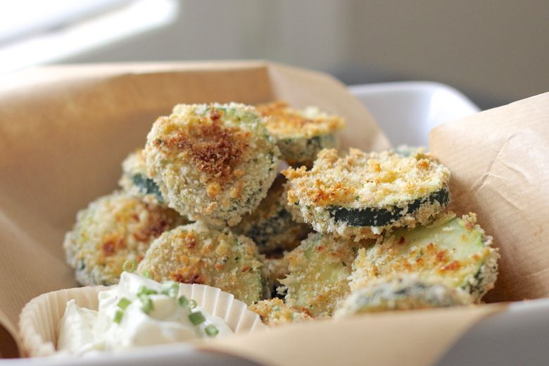 Baked Zucchini stacked in a bowl with Skinny Buttermilk Ranch next to it.