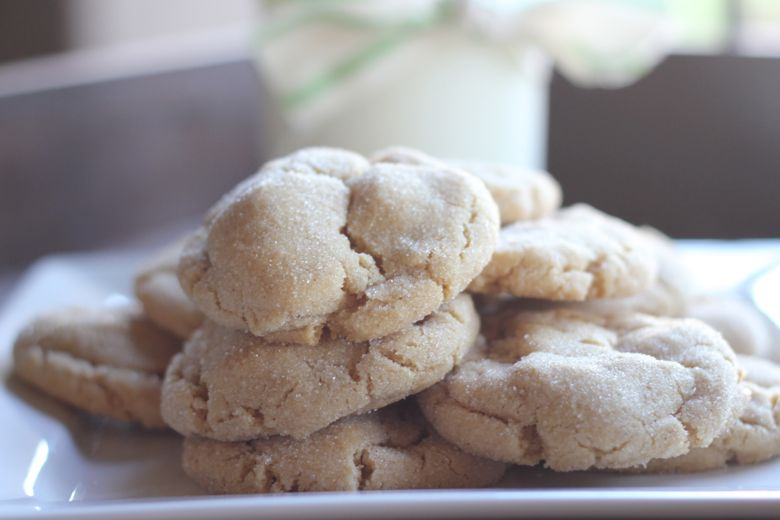 Brown Butter Sugar Cookies stacked on a plate.