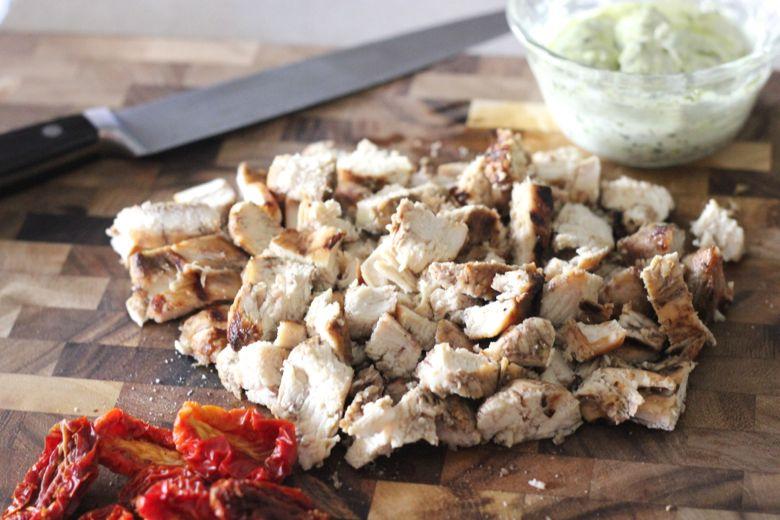Sun-Dried Tomato Pesto Rotini ingredients on a cutting board.