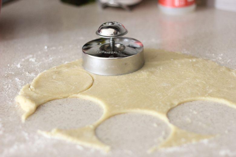 Peach Hand Pie crust dough being cut into circles.