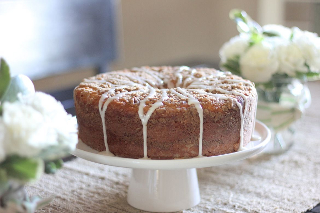 Greek Yogurt Coffee Cake on a cake stand.