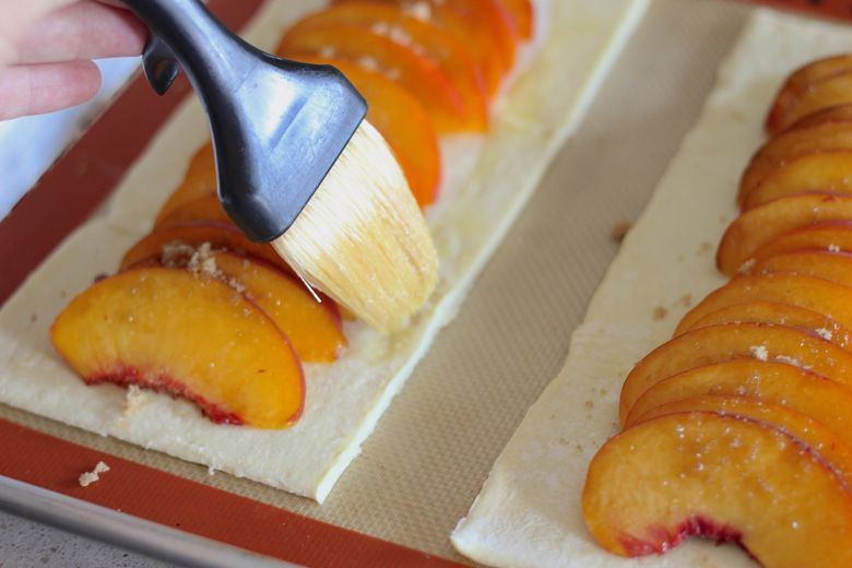 Egg wash brushed on edges of assembled Peach Tart before baking.