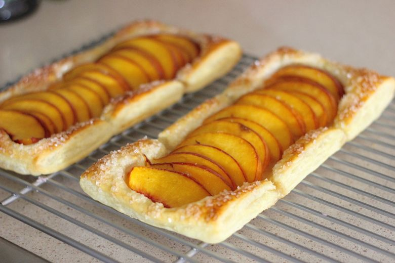 Peach Tarts on cooling rack.