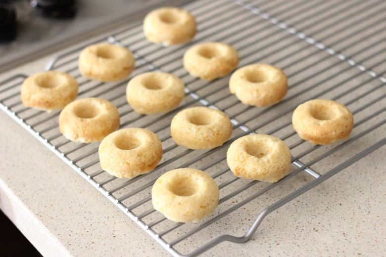 Sugar Cookie Donuts on a cooling rack.