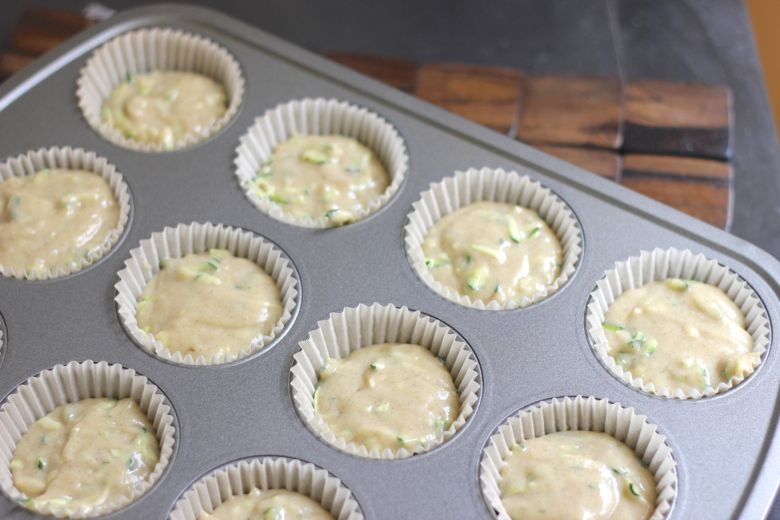 Zucchini Almond Cupcake batter in lined muffin tin.