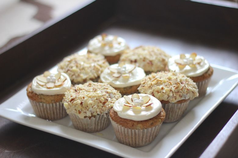 Zucchini Almond Cupcakes decorated and displayed on a platter.