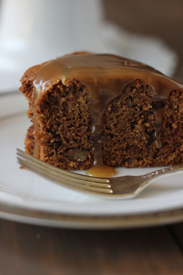 A slice of Applesauce Cake With Butterscotch Sauce on a plate with a fork.