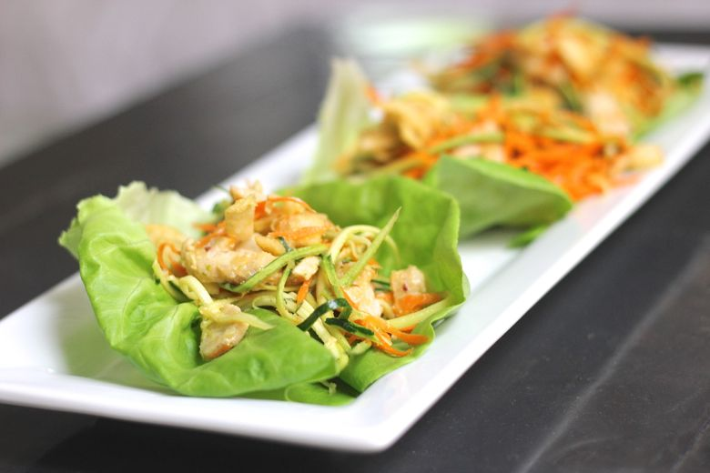 Asian Chicken Veggie Wraps with butter lettuce leaves.