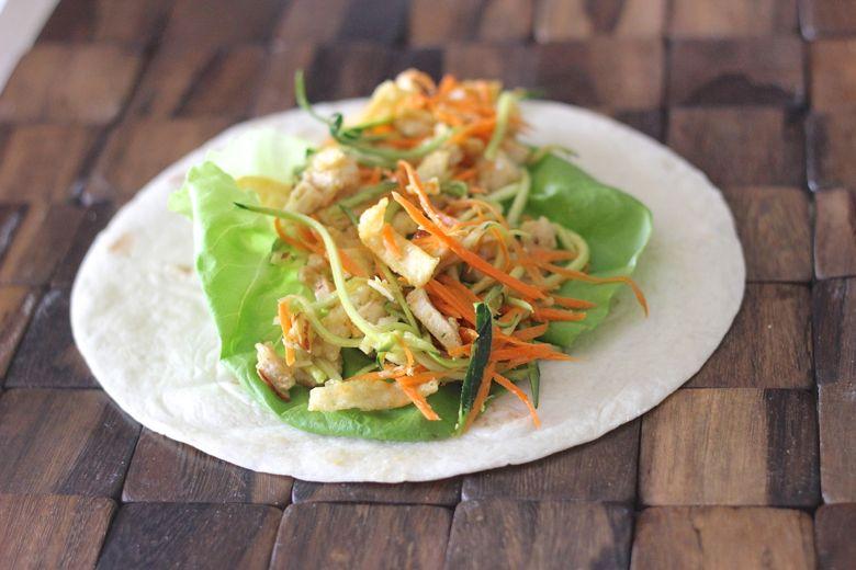 Asian Chicken Veggie Wraps placed in a tortilla.