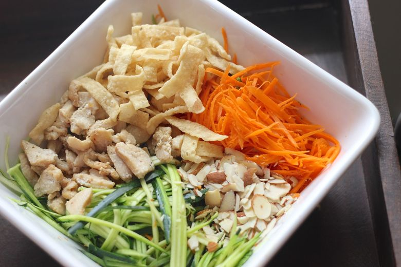 Asian Chicken Veggie Wrap filling ingredients in a large bowl.