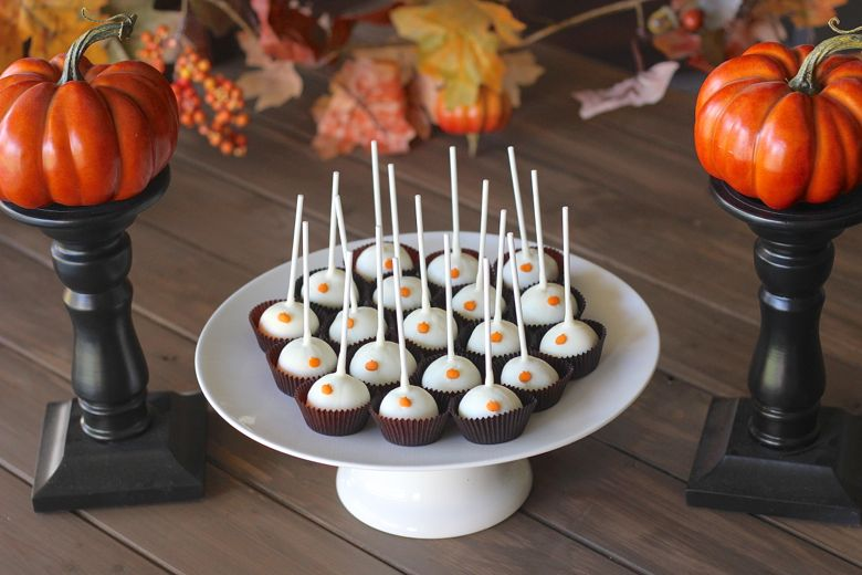 Pumpkin Pie Truffle Pops displayed on a cake stand.