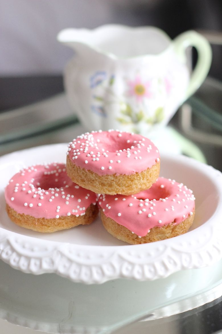 Sugar Cookie Donuts stacked on a plate.