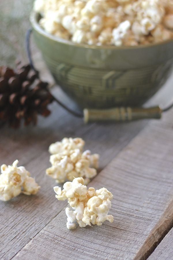 No Bake Caramel Corn in a bowl with a few pieces on a board.