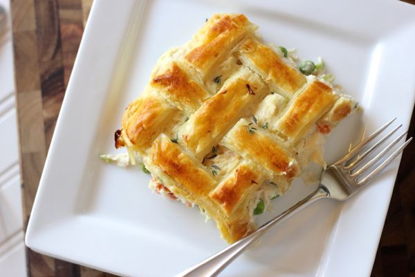 Chicken Pot Pie piece on a plate with a fork.