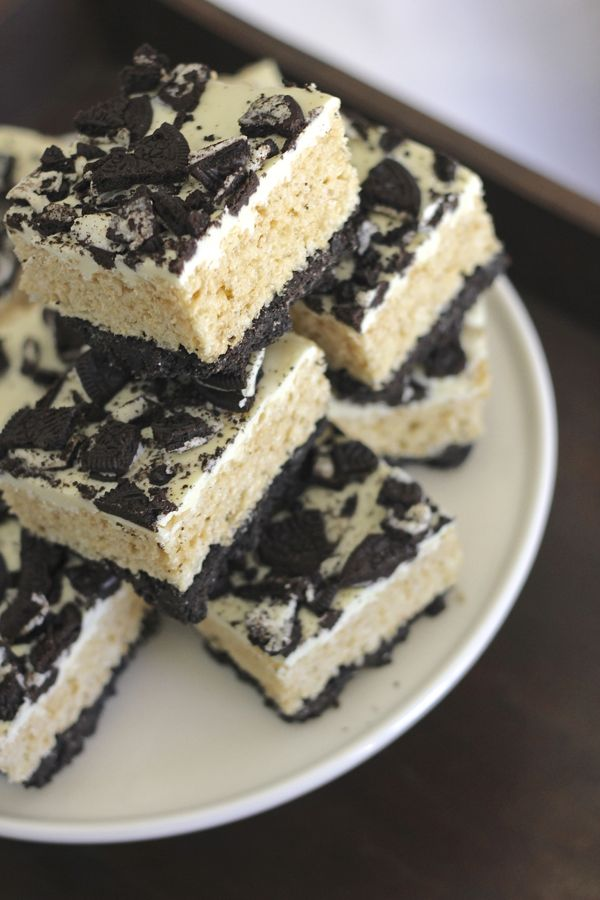 Cookies and Cream Rice Krispie Treats cut in squares and stacked on a plate.