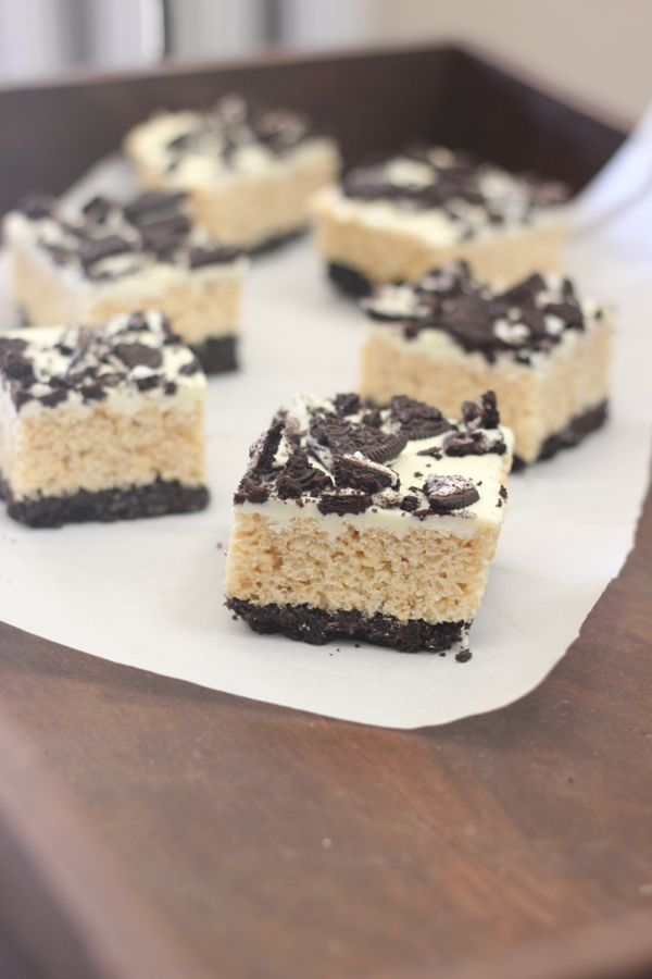 Cookies and Cream Rice Krispie Treats cut in squares on parchment paper.