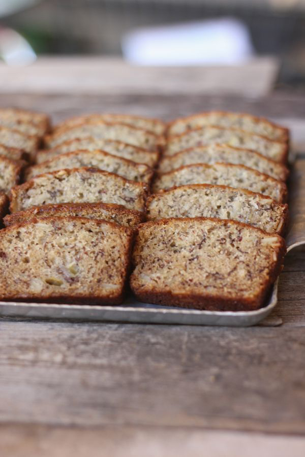 Greek Yogurt Banana Bread sliced and arranged in rows on a serving tray.