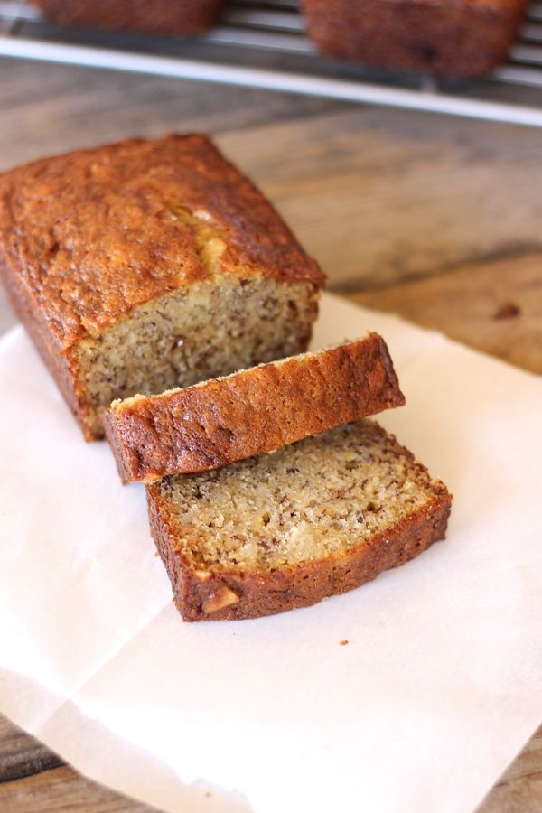 Greek Yogurt Banana Bread loaf with two slices.