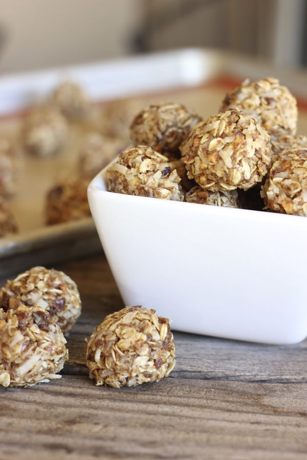 Honey Oat Energy Bites piled in a bowl with a few outside of the bowl.