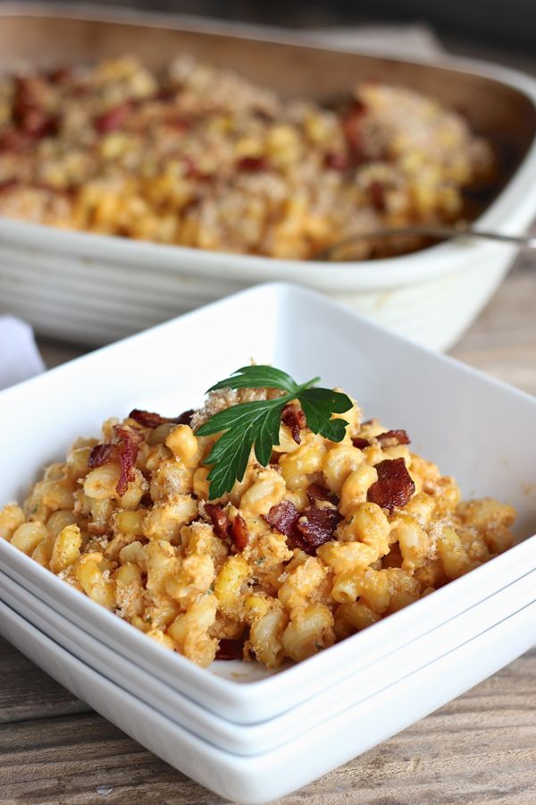 Pumpkin Mac and Cheese With Bacon in a bowl with garnish on top.