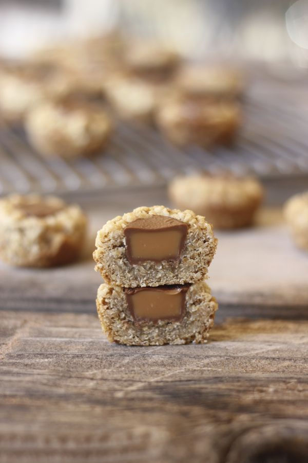 Rolo Oatmeal Cookie Cup sliced in half and stacked.