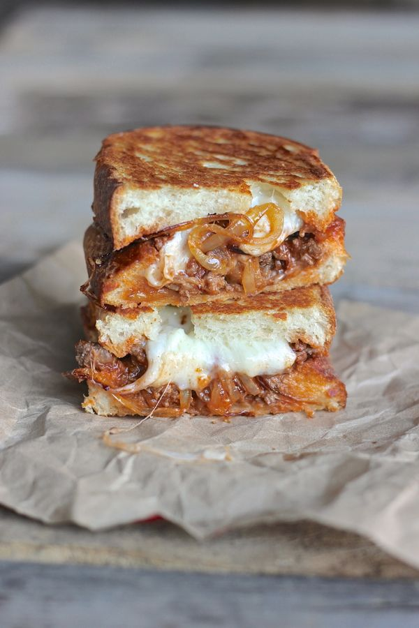 Sloppy Joe Panini With Baby Swiss and Caramelized Onions cut in half and stacked.