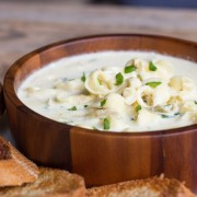 A creamy soup flavored with garlic, artichoke hearts, parmesan cheese, cream cheese, and cayenne pepper