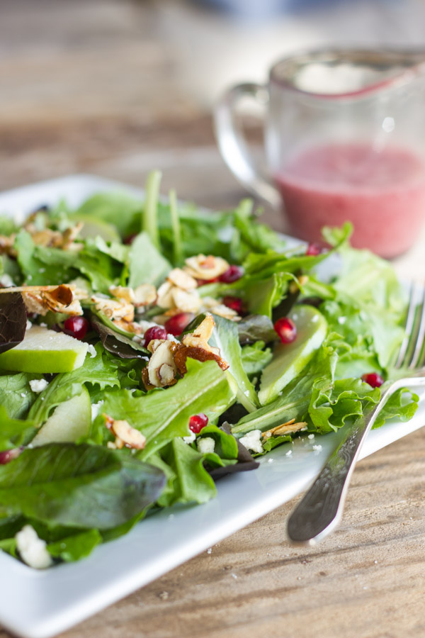 Harvest Salad With Cranberry Vinaigrette on a plate with a fork.