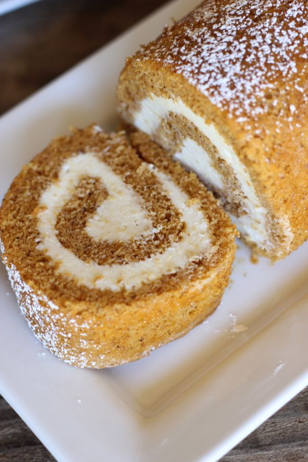 A top down view of a slice of pumpkin rolls showing the swirled filling.