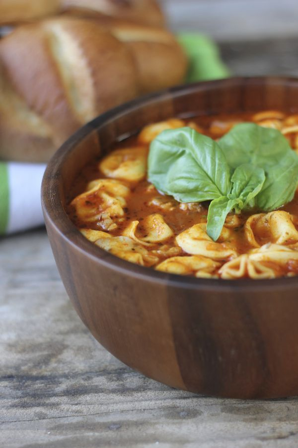 Easy Tomato Basil Soup With Chicken Sausage and Cheese Tortellini in a bowl with garnish on top.
