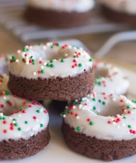 Iced Chocolate Donut Cookies - tiny bites of chewy chocolate cookie with powdered sugar icing and red and green nonpareils