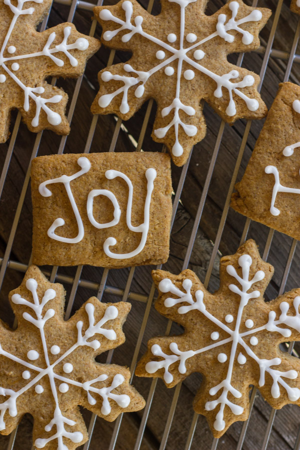 Iced Graham Cracker Snowflakes on a cooling rack.