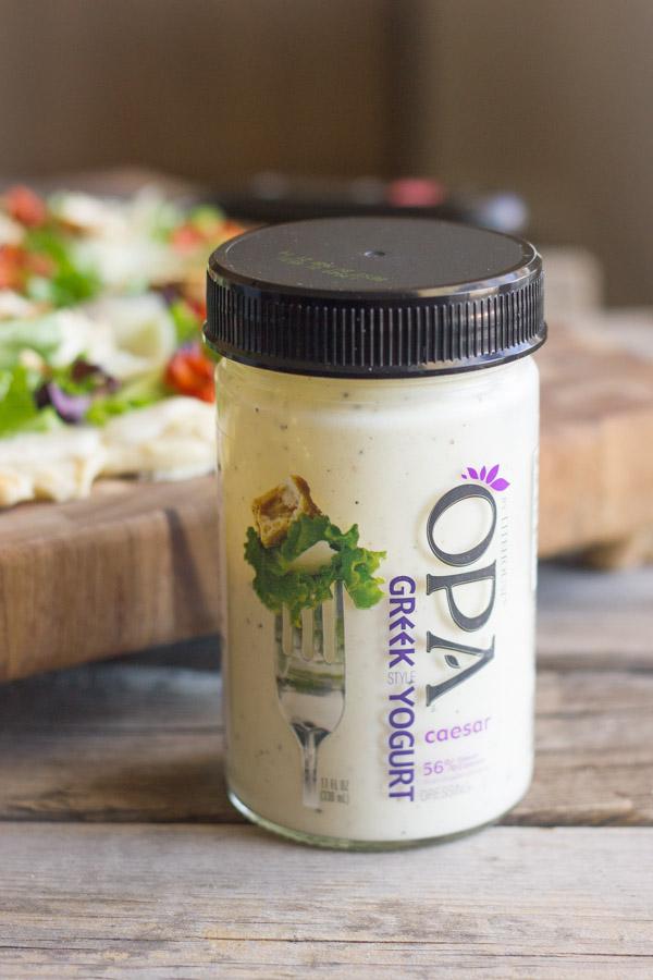 A jar of Opa Greek Yogurt Caesar dressing.