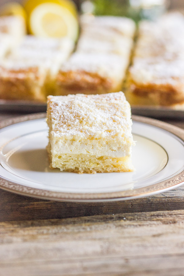 Greek Yogurt Cream Cheese Lemon Coffee Cake square piece on a plate.