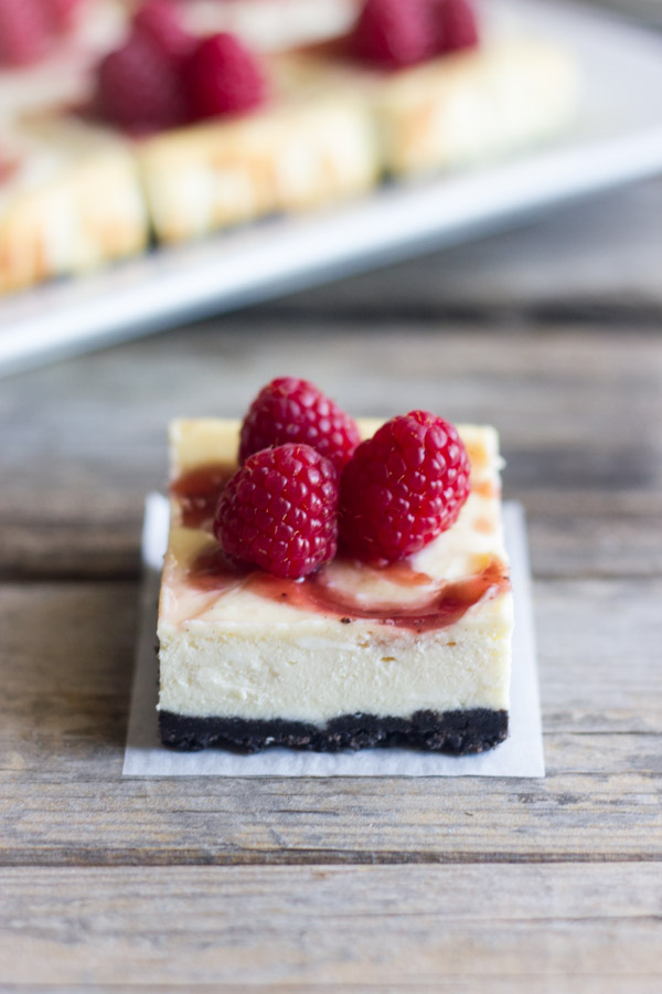 Cute little cheesecake bars with a raspberry swirl and an Oreo crust.
