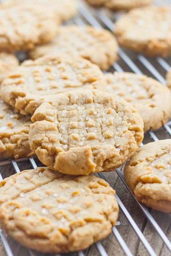 Brown Butter Peanut Butter Cookies stacked on a cooling rack.