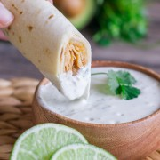 Sweet and spicy shredded chicken wrapped up in a crispy, crunchy baked tortilla with some Cilantro Lime Cream for dipping
