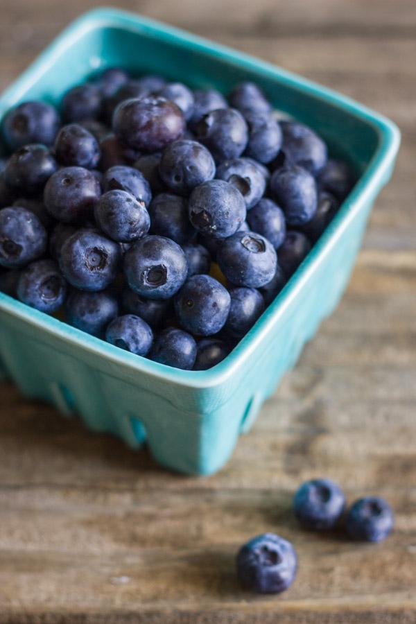 A carton of fresh blueberries.