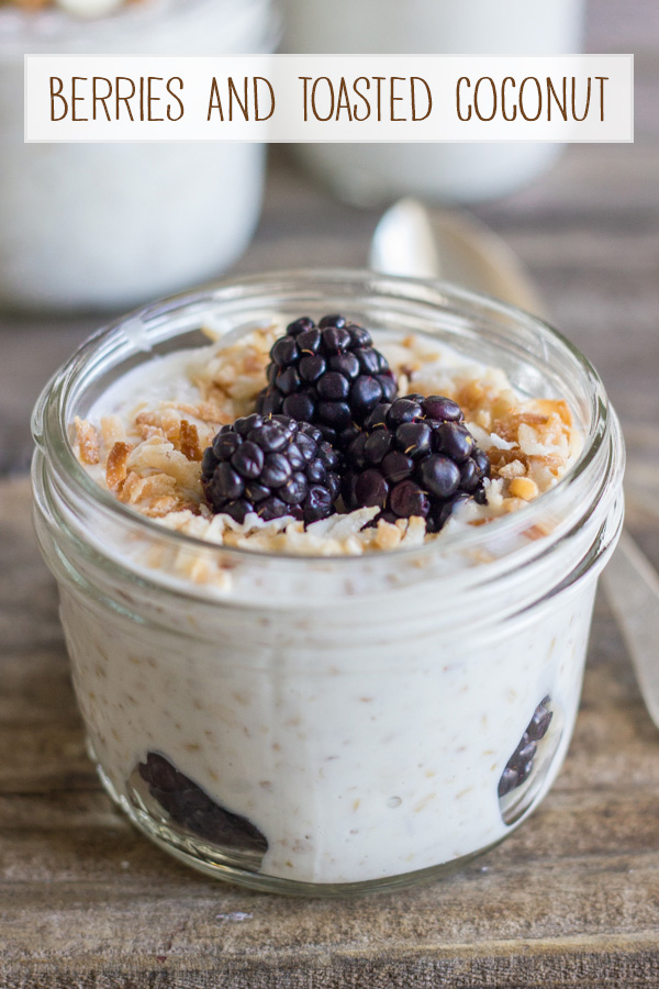 Overnight Steel Cut Oatmeal with berries and toasted coconut in a glass jar.