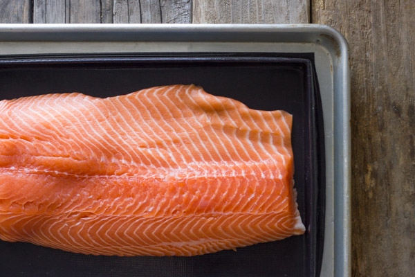 Salmon placed on the Silpat Entremet non-stick baking pan that is on an aluminum baking sheet.