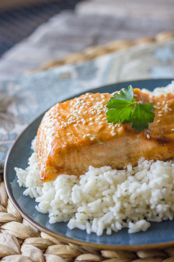 Teriyaki Glazed Salmon served on top of a bed of white rice.