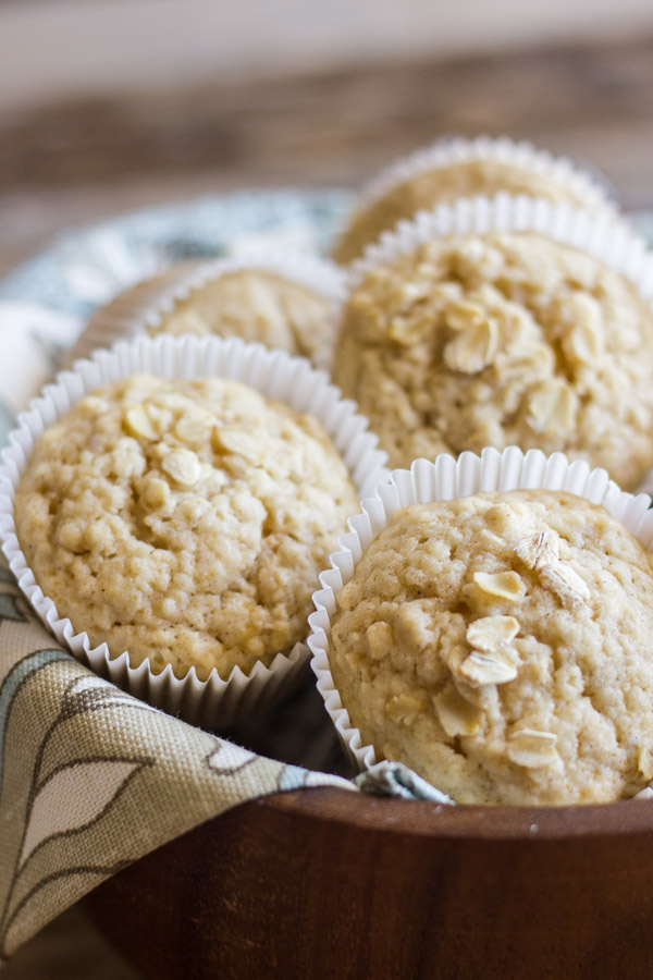 Healthy Applesauce Oat Muffins in a clothed lined bowl.