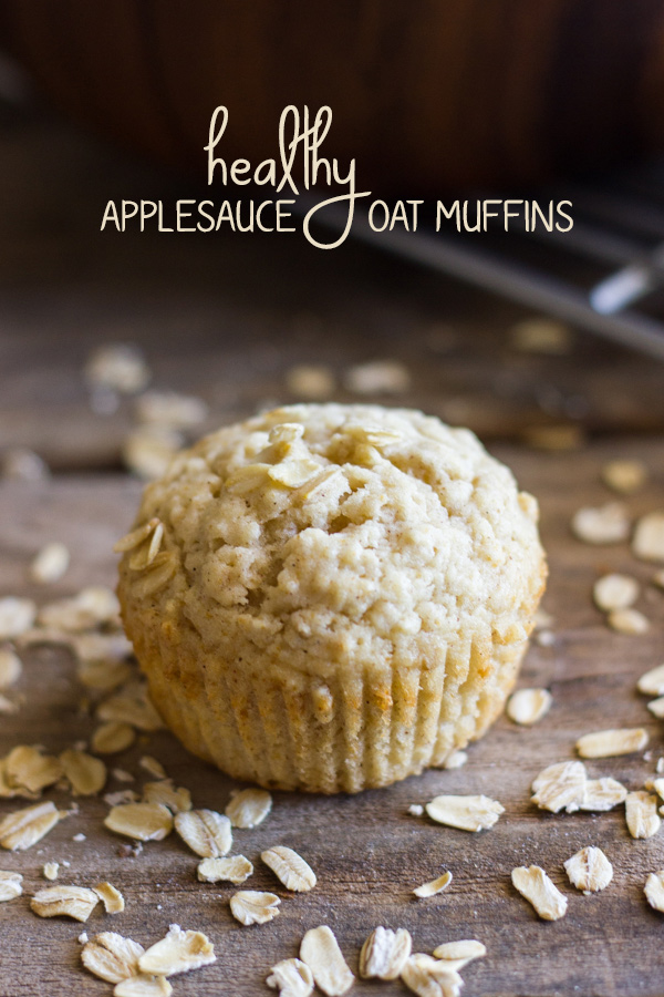 Healthy Applesauce Oat Muffin with oats sprinkled around it.